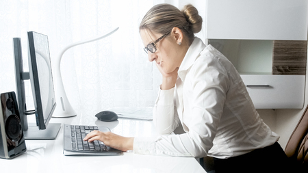 Portrait of stressed businesswoman working on computer at office