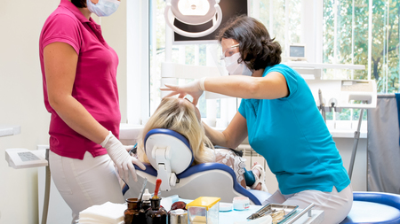 Young woman patient having teeth tretment in dentist office Stock Photo