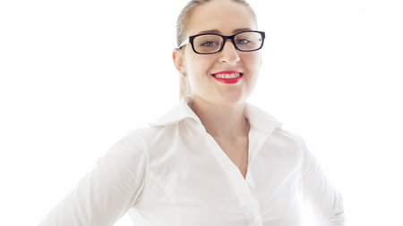 Isolated portrait of young smiling businesswoman in eyeglasses