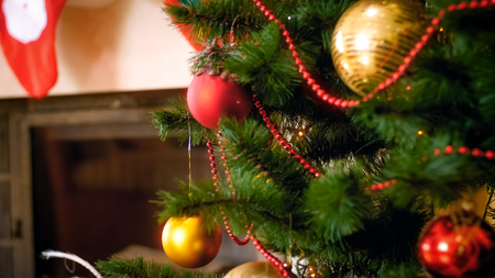 Closeup image of beautiful adorned Christmas tree in living room