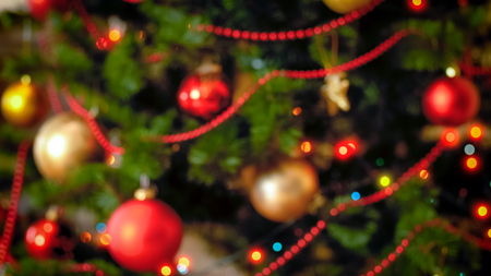 Blurred background for winter celebrations with decorated Christmas tree