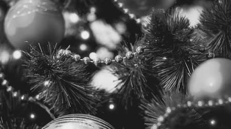 Black and white closeup image of beads and garland on Christmas tree Stock Photo
