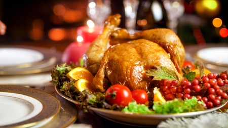 Closeup image of baked turkey on Christmas family dinner in living room