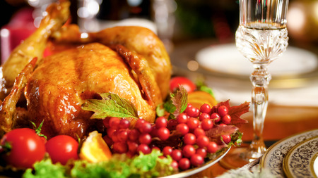 Closeup image of roasted chciken with cranberries on big festive dish
