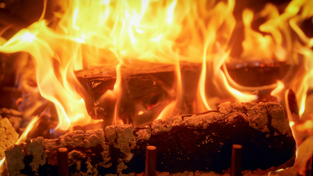 Closeup image of burning wood in fireplace