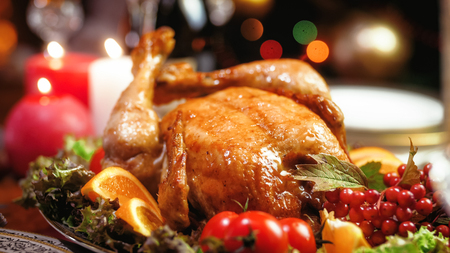 Closeup image of tasty baked turkey on Christmas family dinner Stock Photo