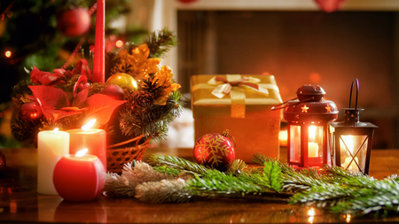 Beautiful image for Christmas background with burning candles, lantern and gift box