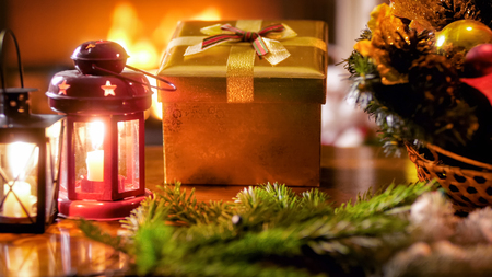 CLoseup image of beautiful Christmas decorations and ornaments against burning fireplace Stock Photo