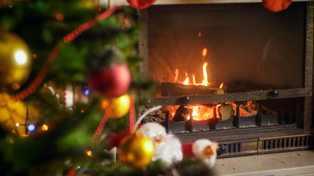 Beautiful firepalce decorated for Christmas at night Stock Photo