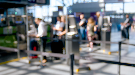 Out of focus photo of people waiting for flight check-in in airport terminal