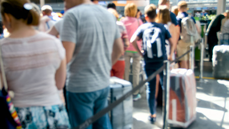 Blurred photo of people waiting for flight in airport terminal Stock Photo