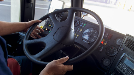 Closeup image of driver driving big truck Stock Photo