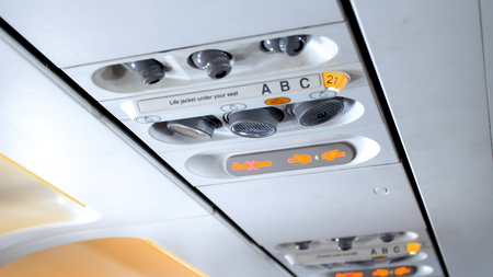 Closeup photo of no smoking and fasten seat belt sign in the passenger airplane Stock Photo