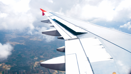 Photo of working airplane wings flaps before landing Stock Photo