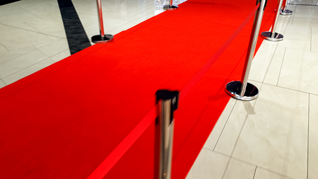 Red carpet road behind the barrier on opening of new store or celebrity awards show Stock Photo
