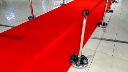 Closeup photo of red carpet road and barriers on the opening of celebrity gala award show