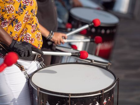 Closeup image of group of musician playing on drums during party or carnival
