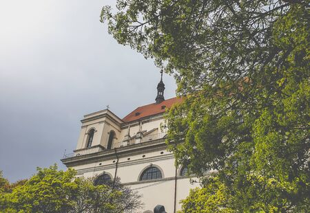 Toned image of beautiful spire on the roof of catholic cathedral against cloudy sky Zdjęcie Seryjne