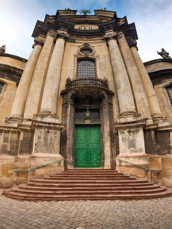 Beautiful panoramic image of entrance door and stone stairs at the old dominican cathedral at Lviv, Ukraine