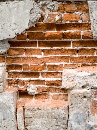 Closeup image of old cracked brick wall