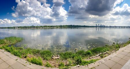 Panoramic image of river Dnipro riverbank overgrown with reed and weeds Zdjęcie Seryjne