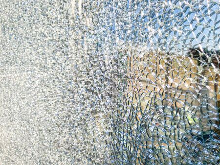 Closeup texture of shattered mirror or glass in lots of small pieces 版權商用圖片