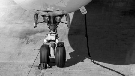 Black and white image of electric power cable and front chassis of airplane during maintenane Reklamní fotografie