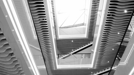 Black and white abstract architecture image of glass roof in modern office building Фото со стока