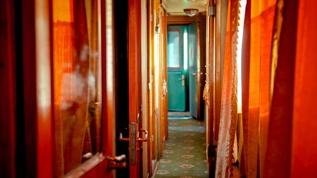 Interior of long hallway in old retro wooden train car