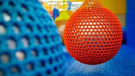 Closeup photo of colroful balls for flyain air yoga hanging in fitness club or gym