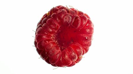Macro image of red raspberry bottom over white isolated background