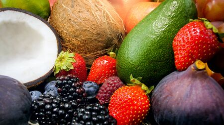 Closeup photo of big assortment of fresh fruits and berries. Helthy nutrition and fruit diet