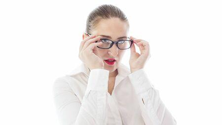 Sexy female teacher with red lipstick adjusting eyeglasses