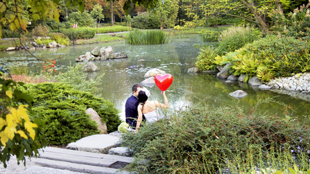 newlyweds: happy newlyweds in japanese garden Stock Photo