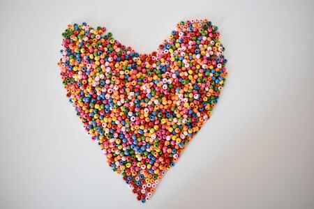 Colorful heart made of wooden beads /