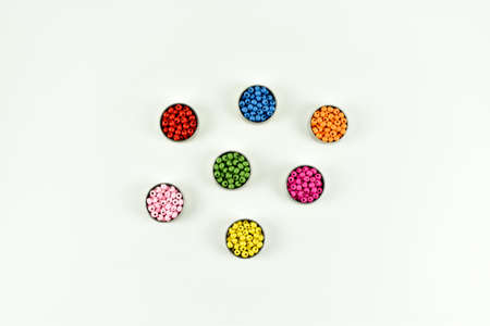 Colorful wooden beads and metal rings.