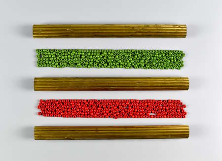 Colorful wooden beads and metal profiles.
