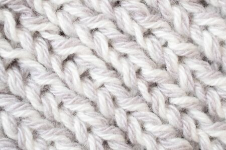 Knitted texture of white color.