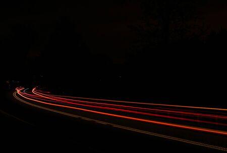 夜の車のライト 写真素材