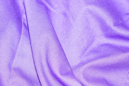 creased purple material texture or background.