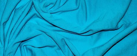 pleated blue material texture or background.