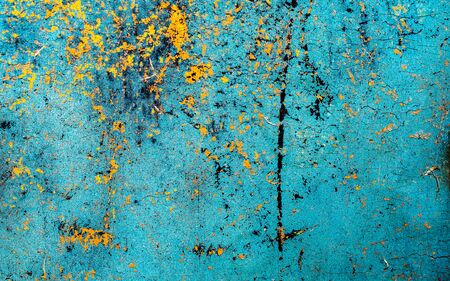 old yellow and blue cracked paint on the wall