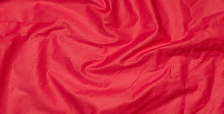 crinkled red textile material with visible texture