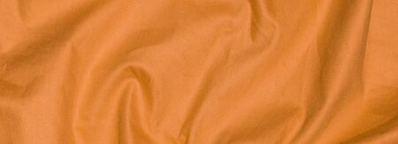 crinkled orange textile material with visible texture Imagens