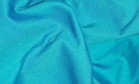 crinkled blue fabric with visible texture Imagens