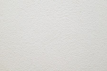 wall painted in white with visible plaster texture