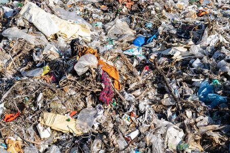 Municipal garbage dump in landfill. Environmental pollution. Stock Photo