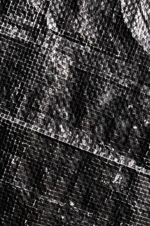 black and white plastic bag surface with blur effect.. Stock Photo