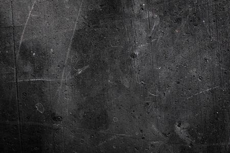 old wall painted with black paint. texture or background