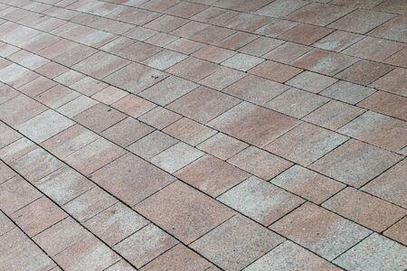 pavement of brown cobblestones. texture.